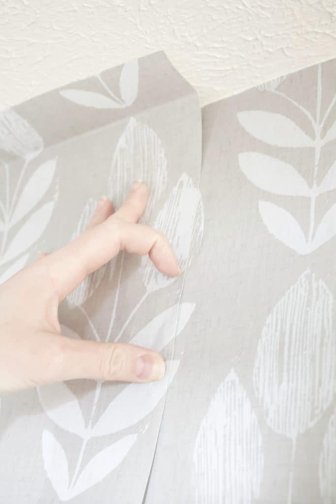 "make sure to leave 1/2"" or more extra wallpaper on top when matching patters as wall heights vary slightly and you don't want to be left with a gap as you progress down the wall."