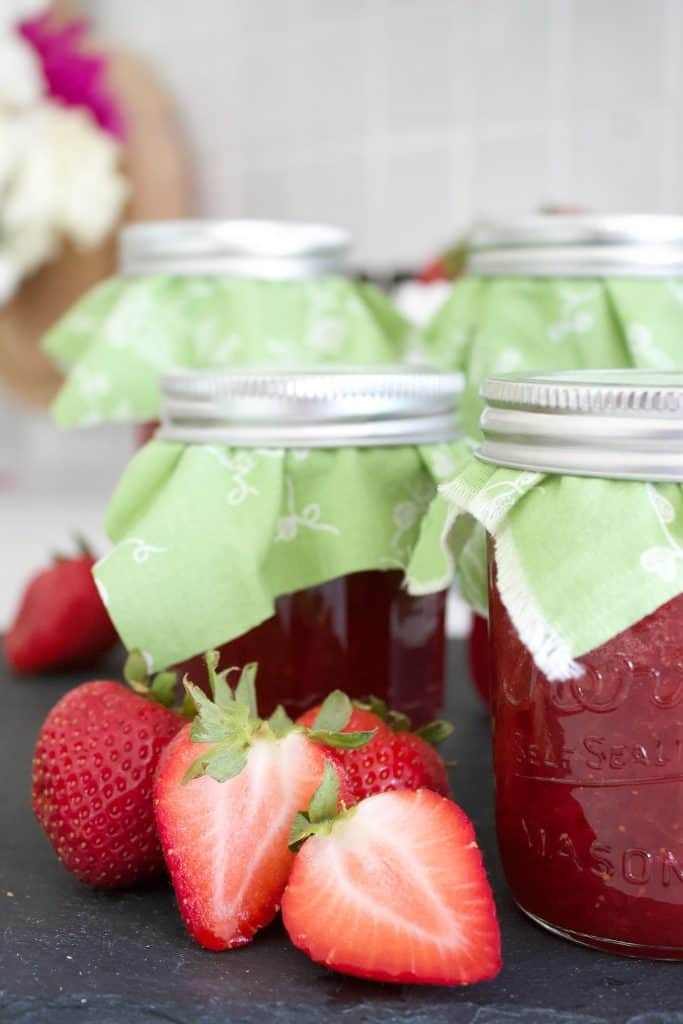 strawberry jam: Easy hot water bath canning.   Strawberry jam has been a staple in our home for as long as I can remember. My mom would make freezer jam from strawberries each year. My favorite was to scoop a big dollop of jam over vanilla ice cream. Summertime was always complete with vanilla ice cream and fresh strawberry jam.