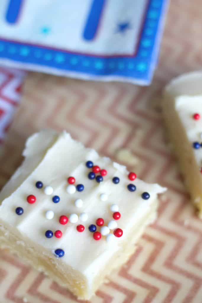 Sugar cookie bars with cream cheese & classic buttercream frosting.