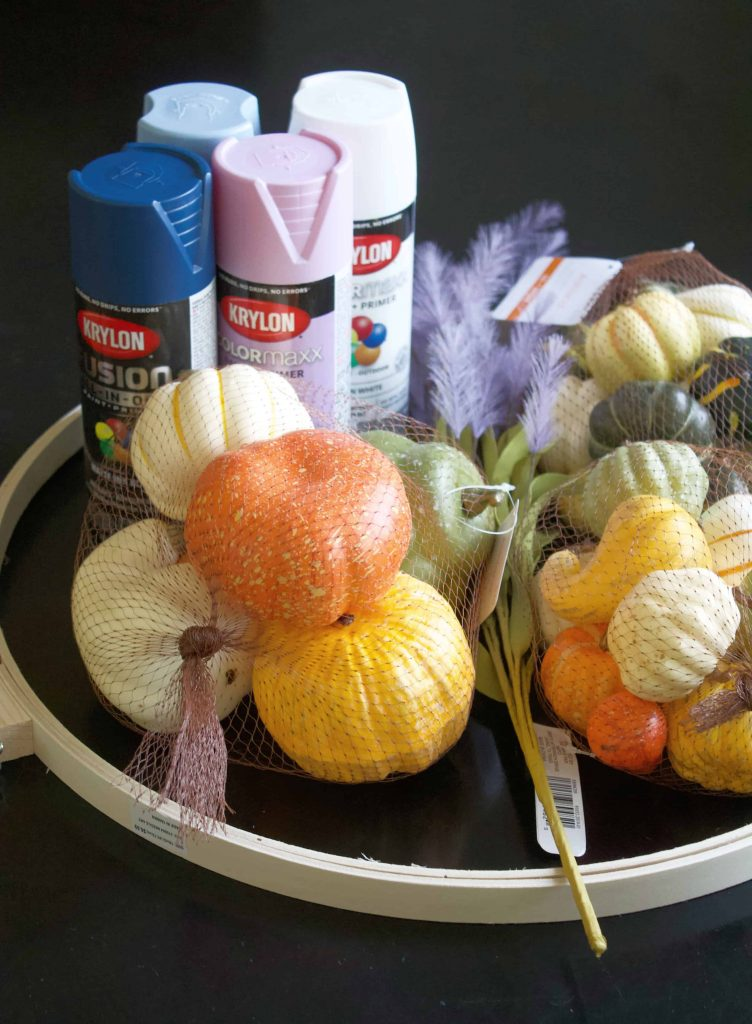 A few cheap pumpkins, some spray paint, and a wooden hoop and you've got all the ingredients for a beautiful fall wreath. Change up the colors and placement to make exactly what you want! #fallwreathdiy #fallwreath