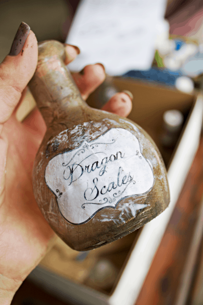 How to distress a potion bottle for halloween decor. #halloweendecor
