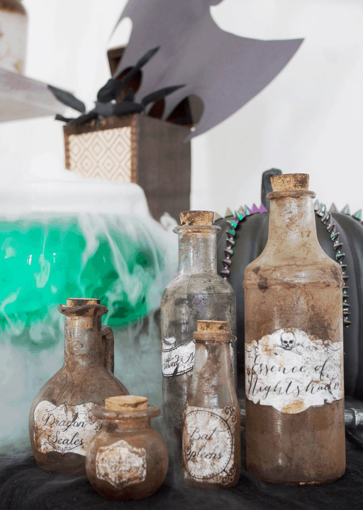 Making Halloween home decor can be fun and easy. Plus it's budget friendly. This DIY tutorial on how to make Witch Potion bottles takes less than an hour. #halloweendecor