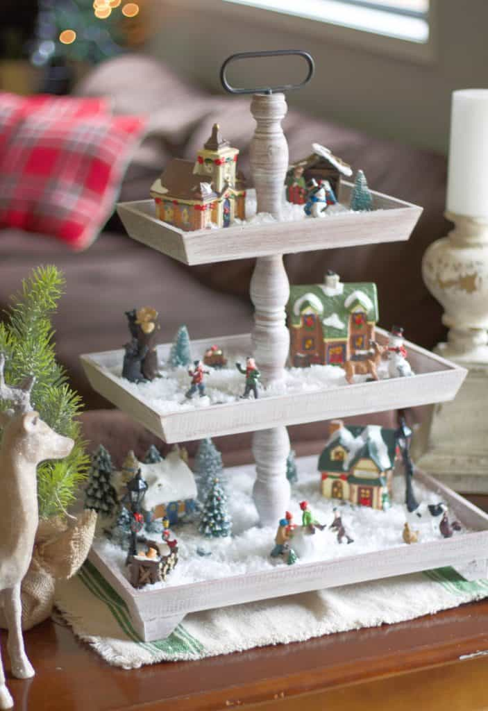 Kid friendly Christmas village decor! Make this easy Christmas village that does double duty as decor and a play set for the kids! #christmasvillage #farmhousechristmas