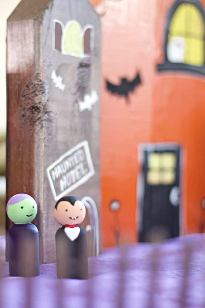 This easy DIY Halloween village is perfect for family friendly Halloween decor. It's cute, not to scary, and the kids can have hours of fun. #halloweencrafts #halloweendiy