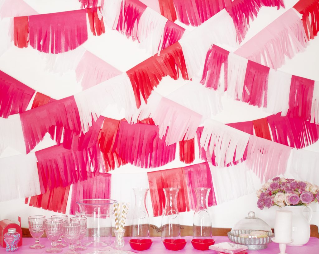 How to Make a Tissue Paper Tassel Garland  DIY tissue paper garland is super easy to make and doesn't require a lot of time or supplies. It's also extremely easy to customize the colors perfect to match any party you're planning!