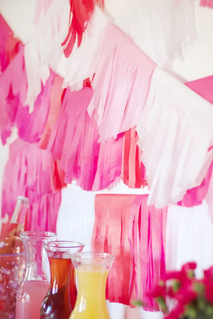 DIY tissue paper garland is super easy to make and doesn't require a lot of time or supplies. It's also extremely easy to customize the colors perfect to match any party you're planning!