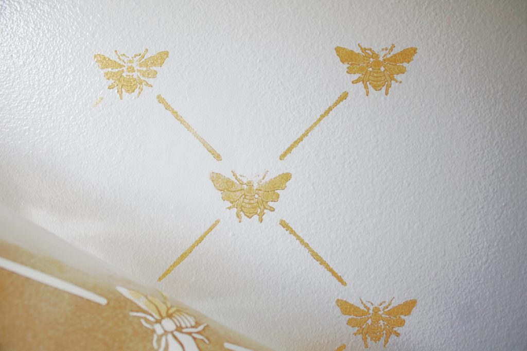 Tips for using a stencil on a slightly textured wall using metallic paint. Also how to stencil a wall corner. My tips and tricks from our farmhouse bathroom refresh! #stenciling #bathroomrefresh #farmhousebathroom