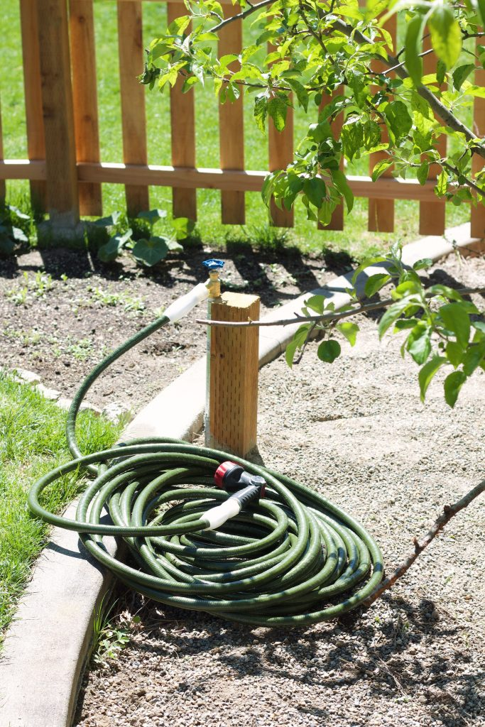 How to make an extended outdoor faucet for a garden or far area of your yard that connects to your main outdoor faucet from your home. #gardening #waterforgarden