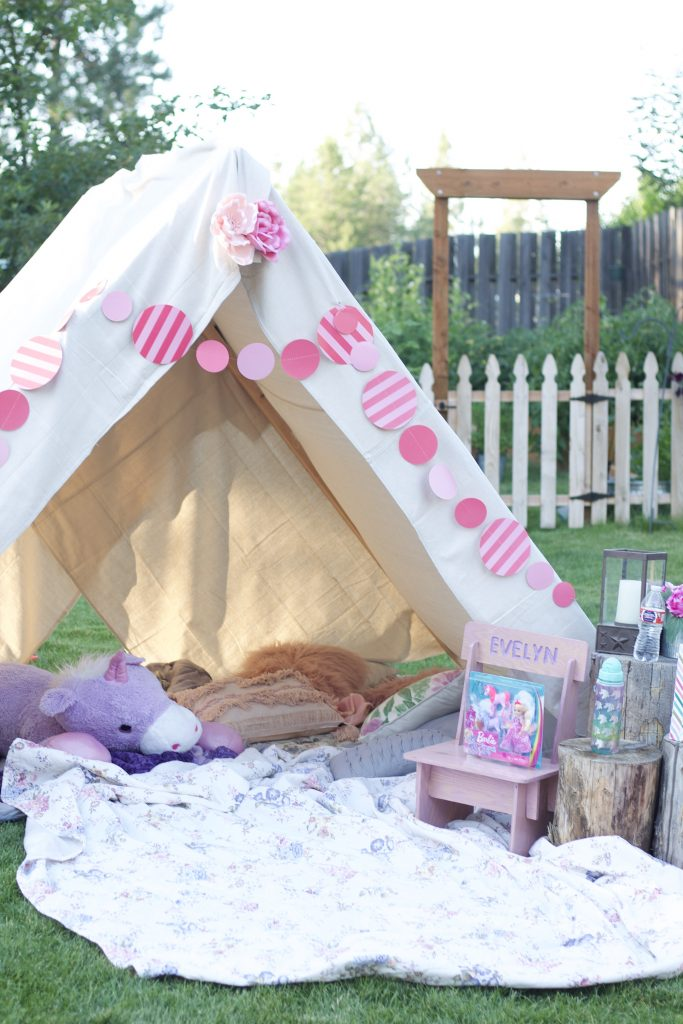 This easy outdoor birthday tent is made from 5 2x4's and 2 painters drop cloths. Simple to construct & budget friends, it's perfect for a summer party!