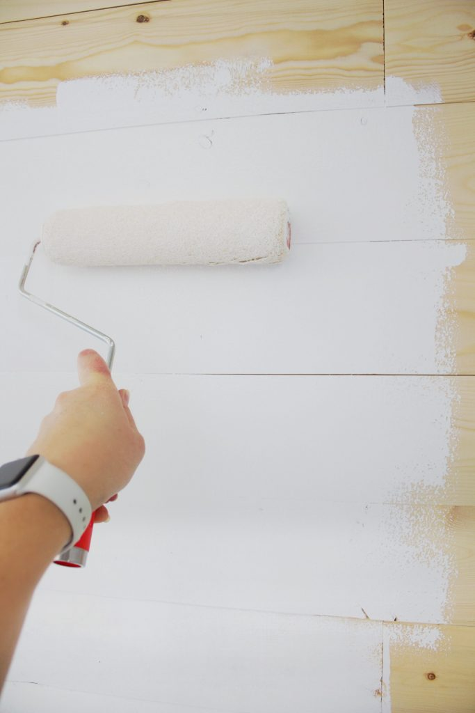 Have questions about how to paint shiplap? Like what paint finish to use on shiplap? How to paint the cracks? Or tounge and groove? #paintingshiplap #howtopaintshiplap