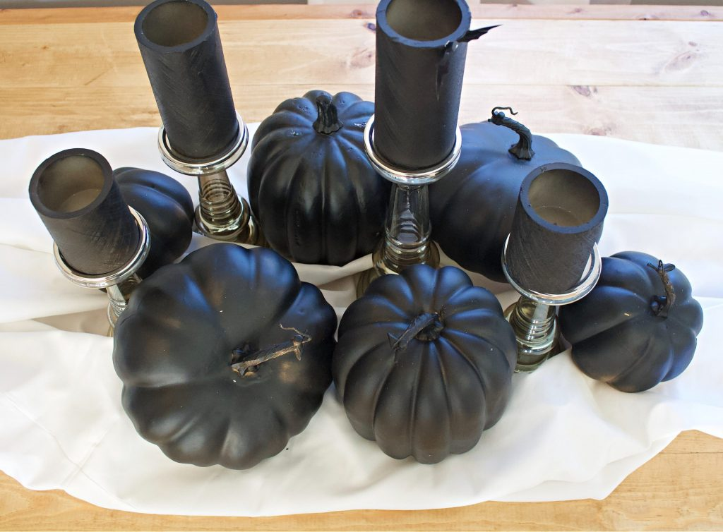 Ideas for Halloween table decor with items you already have on hand. Make this simple, easy, and elegant Halloween centerpiece with black spray paint and a little imagination! #halloweencenterpiece #halloweentablescape