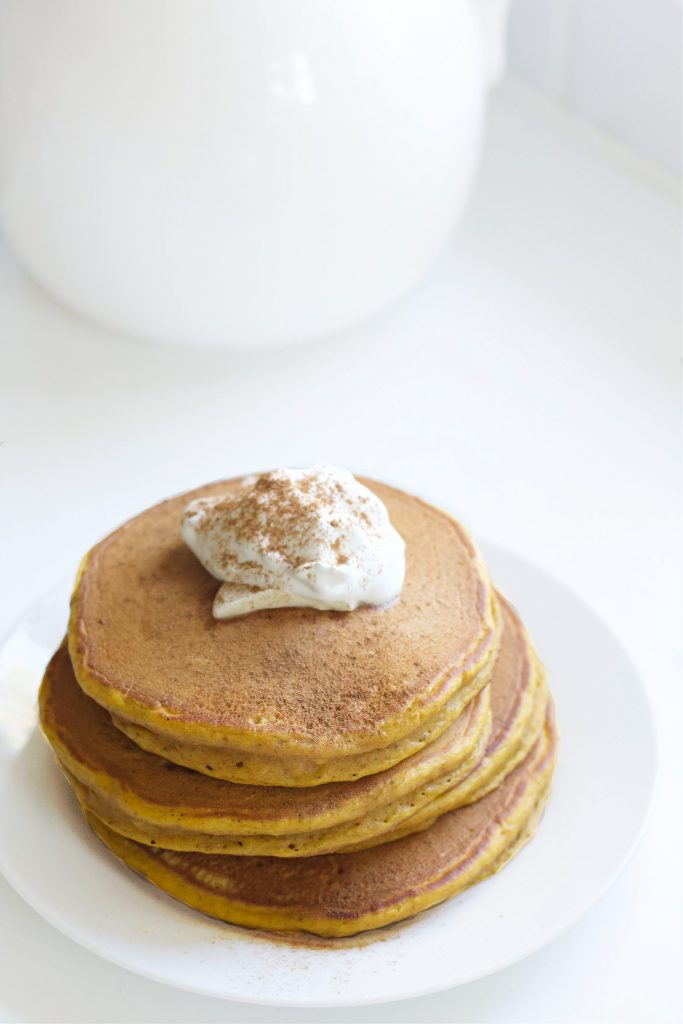 The most glorious fall mornings consist of pumpkin pancakes! These easy to make, fluffy pumpkin pancakes are the perfect way to celebrate autumn. If you have some canned pumpkin in your pantry, your'e ready to whip up a batch right now! #pumpkin #pumpkinrecipes #fall #fallrecipes #breakfast #brunch #breakfastrecipes #pancakes #recipe #easyrecipe #pancakerecipe #pumpkinpancakes #autumn #autumnrecipes