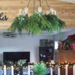 Decorating a Chandelier with Greenery for Christmas