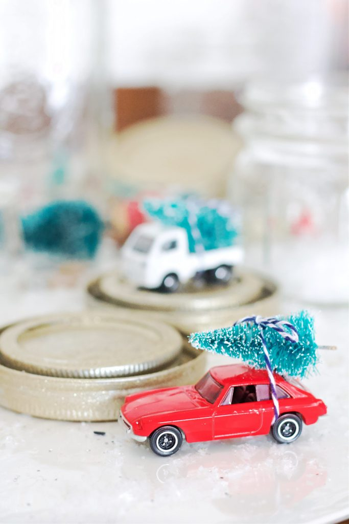 Waterless snow globes so easy to make. A fun project to do with kids, you most likely already have many of the items on hand. Plus you don't have to worry about leaking water with these beautiful globes. #diysnowglobes #snowglobes