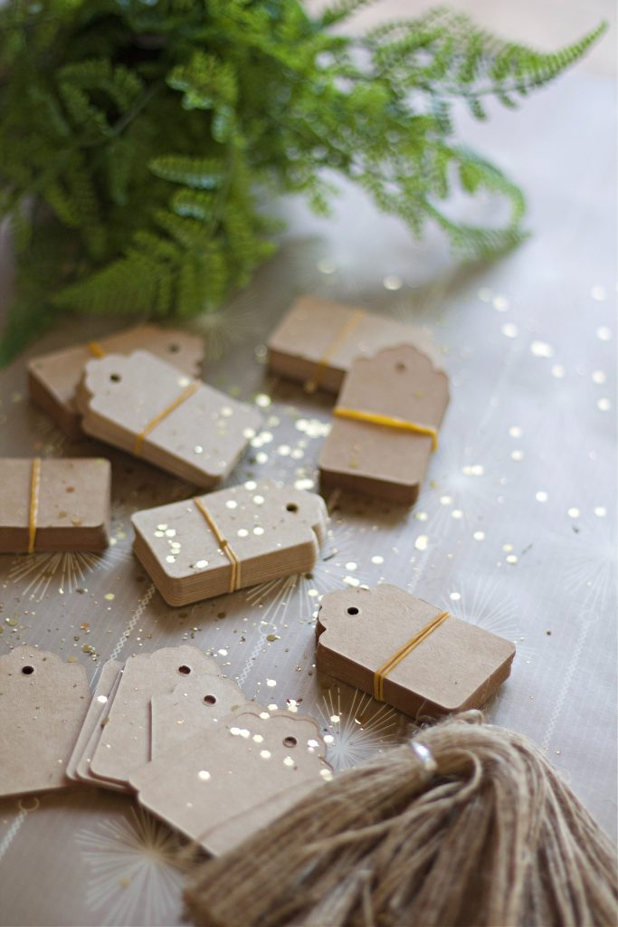 Christmas doesn't have to cost a fortune. These 6 ways to decorate using gift tags are not only budget friendly, but they are beautiful and creative. What else could you make with gift tags? #christmascrafts #christmasdiy