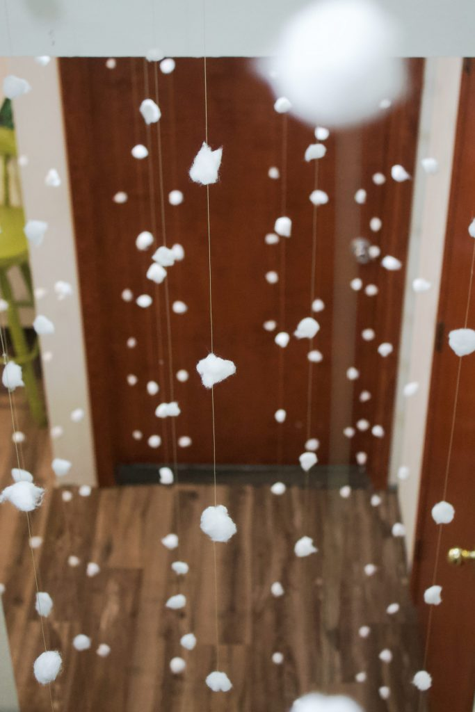 This snow garland cost $1.99 to DIY, and it turned our basement into a winter wonderland. All you need is some string, cotton balls and glue.