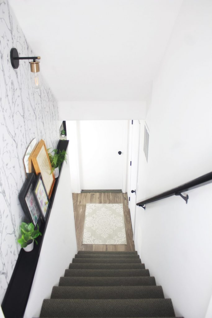 I'm constantly on a mission to brighten my home, and I'm all about hallway decorating. It's a great transitional space to prime your guests for the next room they enter! #hallwaydecor #hallway hallway decorating