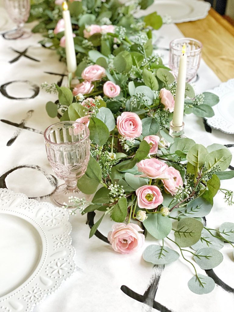 Easy, romantic table decor. The blush pinks of the ranunculus and the blue green leaves remind me of a meadow in springtime.