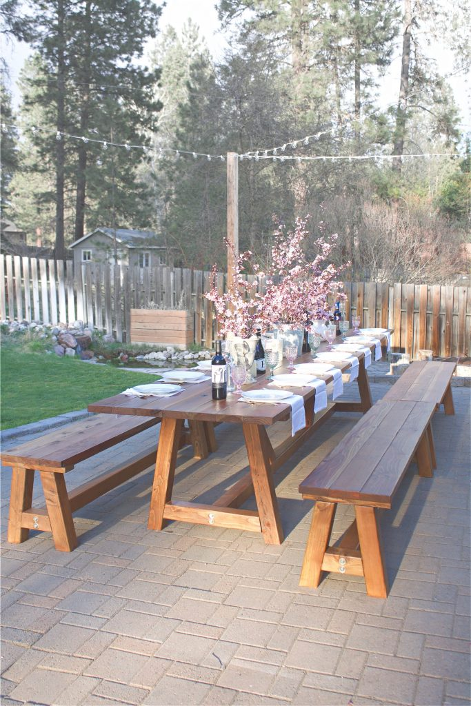 This Pinterest worthy outdoor table was constructed in two days, and took another three days total to sand, stain, and poly. It's the perfect outdoor wooden table. This pine table sits 16 comfortable on the sides, with another 2 possible at each end, for a total of 20 people! Considering all our outdoor gatherings, it's the perfect outdoor accessory.
