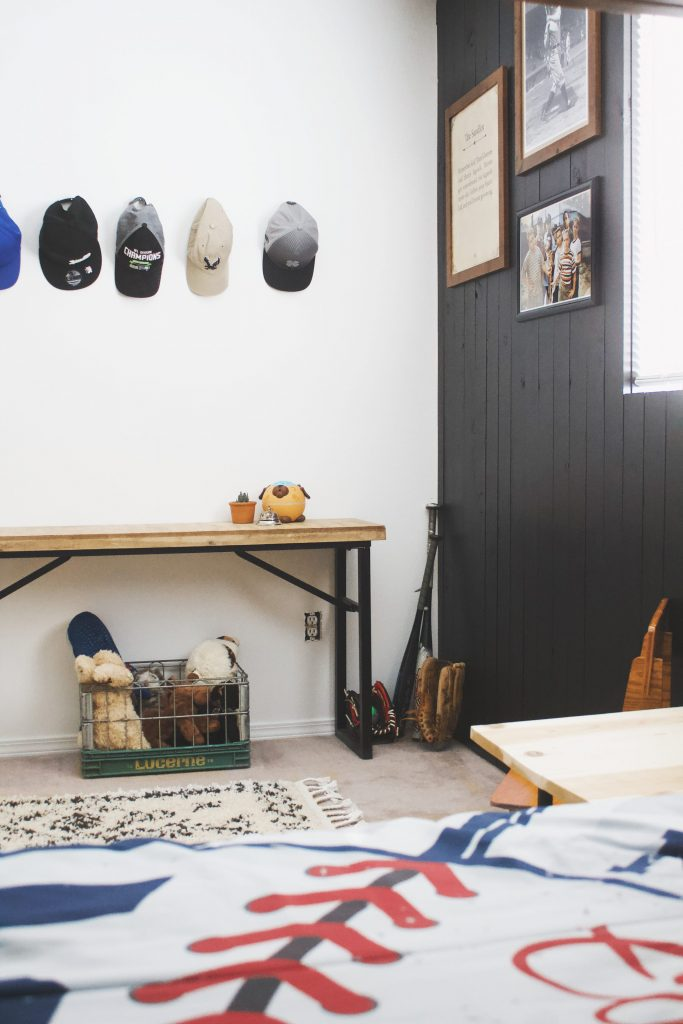 This vintage baseball-themed room with a Sandlot twist is the perfect combo of fun for the kids while also keeping it aesthetically pleasing. #baseballroom #sandlot