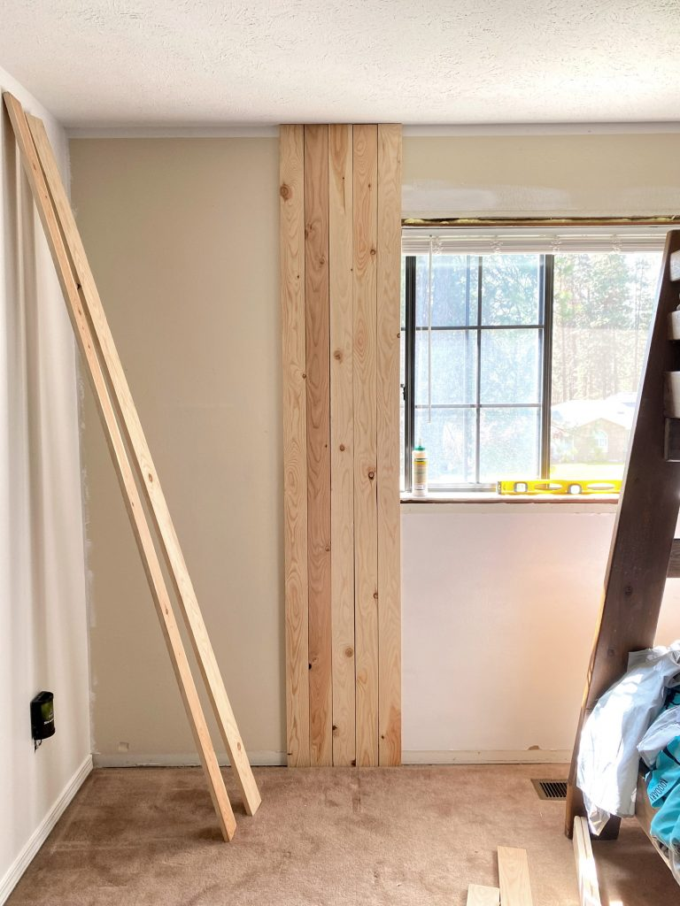 The easy process on how to secure vertical shiplap to a wall. #vetricalshiplap #shiplap
